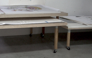 bottom lighting design and installation for working and presentation in an artists studio the table tops are only 2 12 thick but can span 8 artists studio lighting